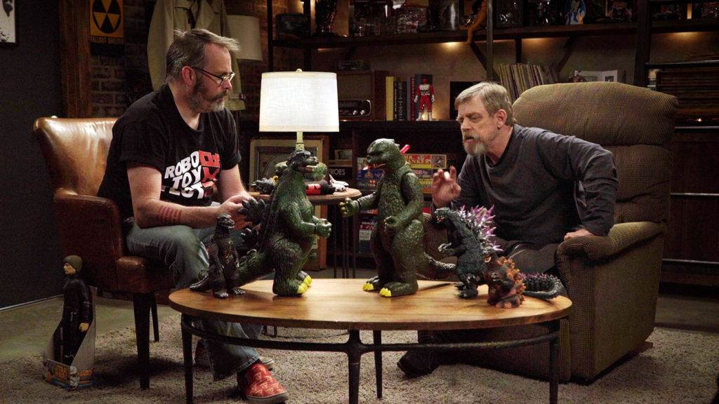 Scott and Mark Hamill compare the Japanese and US versions of Godzilla toys.