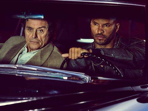 Shadow Moon (Ricky Whittle) drives Mr. Wednesday (Ian McShane) on his road trip in 'American Gods' on Starz.