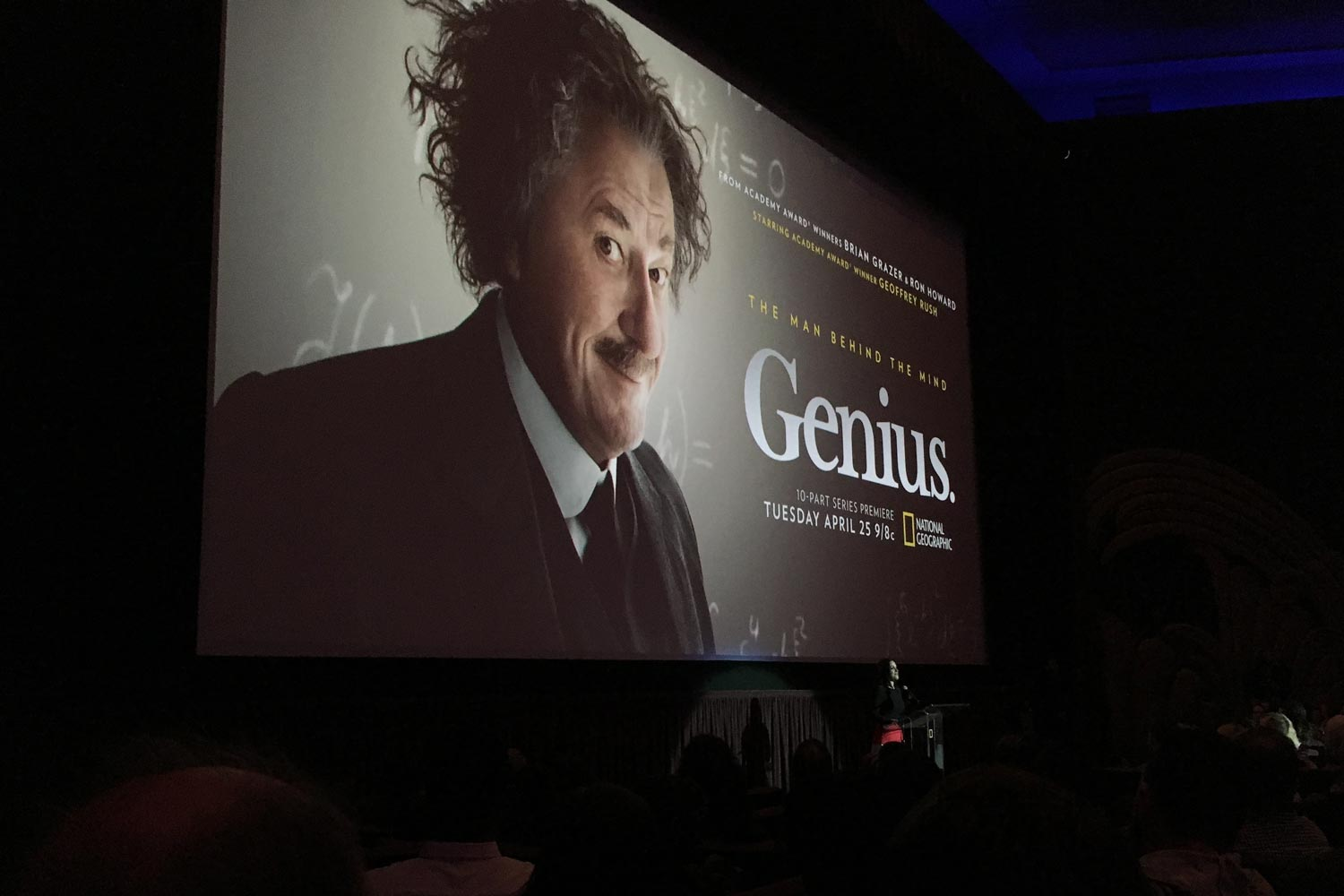 'Genius' title card on movie screen