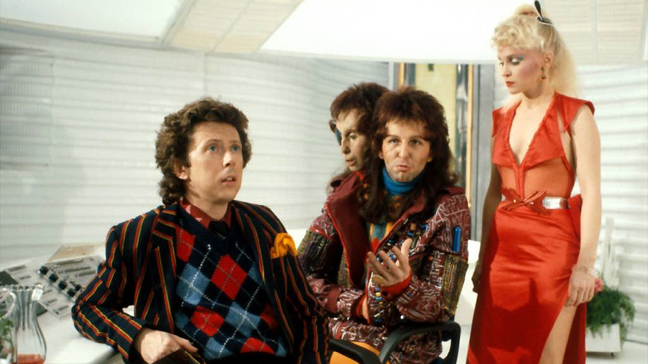 Ford Prefect (David Dixon), Zaphod Beeblebrox (Mark Wing-Davey) and Trillian (Sandra Dickinson) in the TV version of H2G2.
