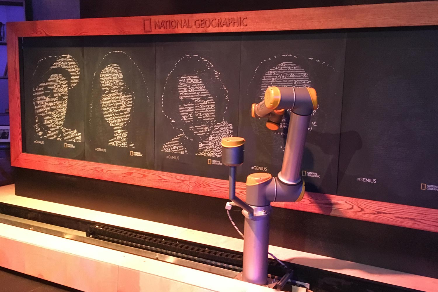 Robot arm draws chalk portraits of Twitter followers using mathematical equations.