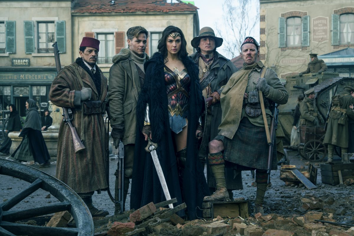 "(l-r) SAÏD TAGHMAOUI as Sameer, CHRIS PINE as Steve Trevor, GAL GADOT as Diana, EUGENE BRAVE ROCK as The Chief and EWEN BREMNER as Charlie in the action adventure ""WONDER WOMAN."" ©Warner Bros. Entertainment/Ratpac Dune Entertainment. CR: Clay Enos."